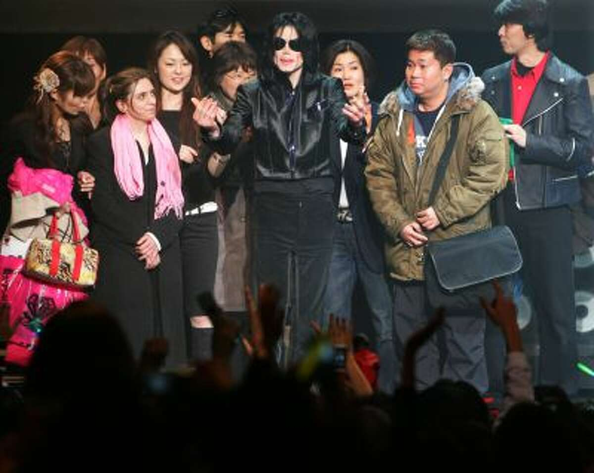 """In this March 9, 2007 file photo, U.S. pop singer Michael Jackson greets his fans during a """"Fan Appreciation Day"""" in Tokyo."""