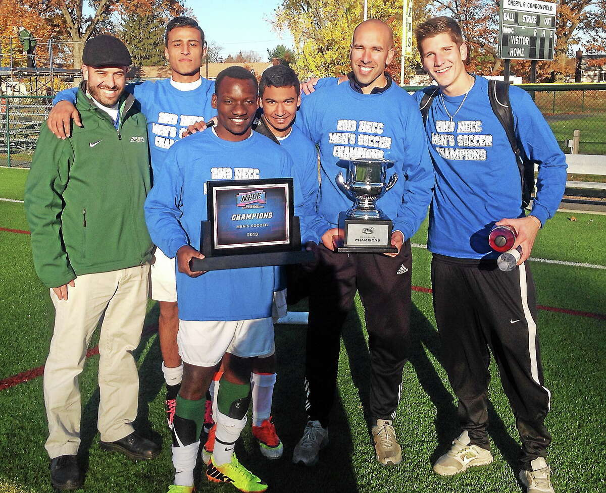Coach Jared Sheikh, second from right, along with some of his players, after leading Elms College to the NECC conference championship this past fall and a berth in the Division III NCAA Tournament.