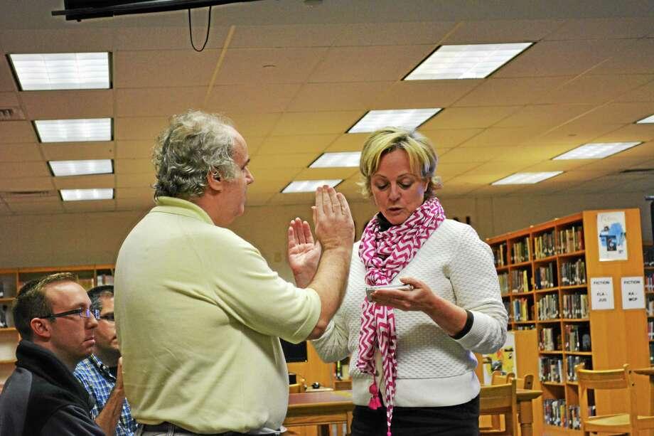Bill Knight was sworn as a member of the Torrington Board of Education Wednesday by Mayor Elinor Carbone. Photo: Ryan Flynn — THe Register Citizen