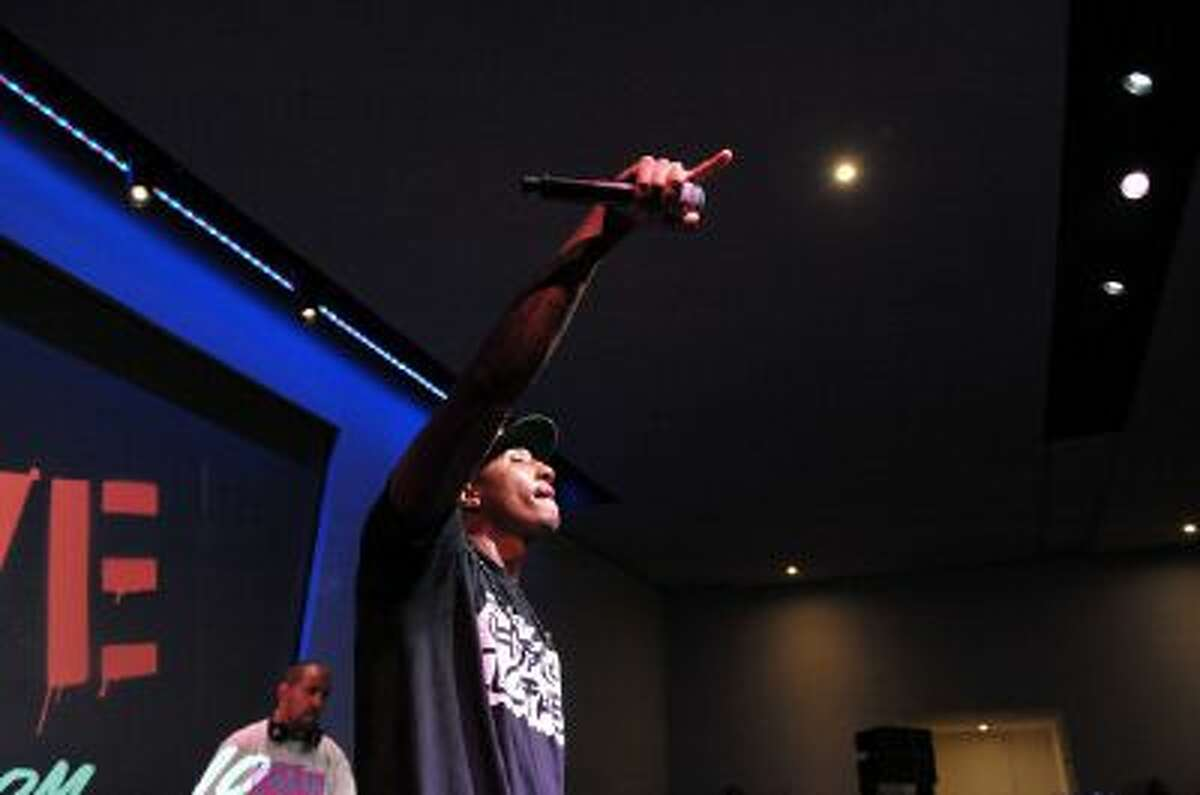 Lecrae Moore performs at the Apple Store Soho on July 17, 2012 in New York City.