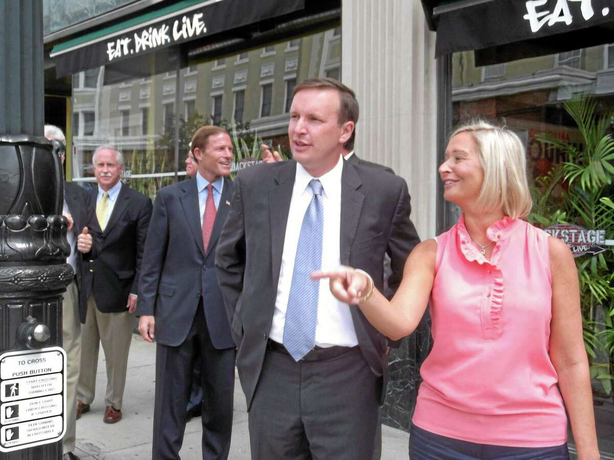 Torrington Economic Development Director Rose Ponte highlights a few businesses downtown for then-U.S. Rep. Chris Murphy, who was in town with other federal and state legislators in August 2012. The city of Torrington was the recipient of a $500,000 grant for its streetscape project.