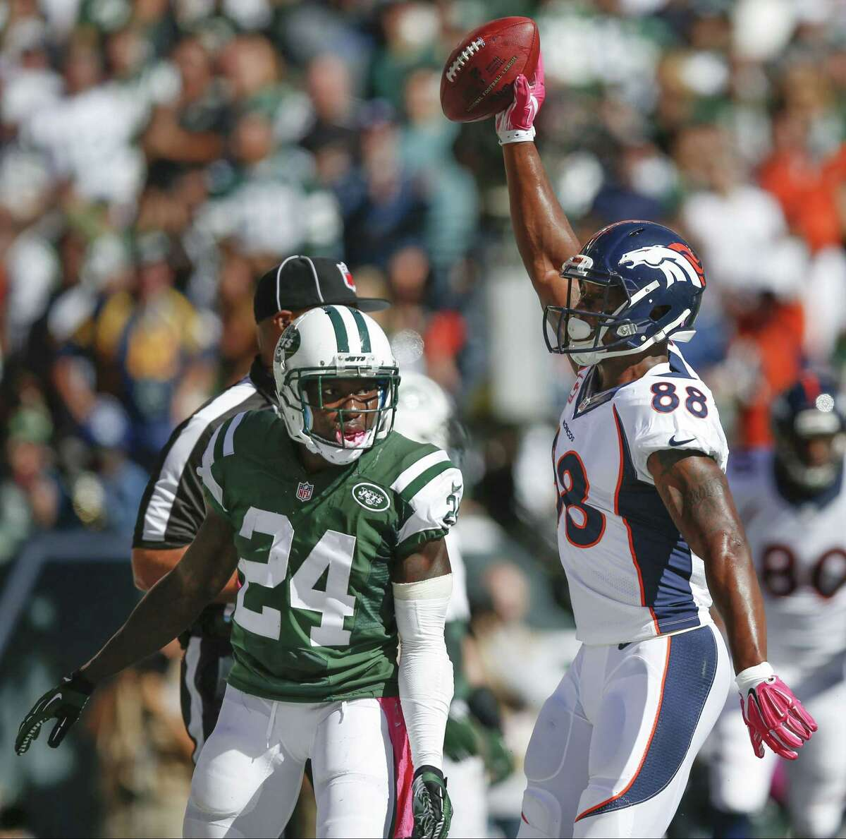 Denver Broncos receiver Demaryius Thomas (88) reacts after catching a touchdown pass against New York Jets defensive back Phillip Adams (24) in the second quarter Sunday in East Rutherford, N.J.