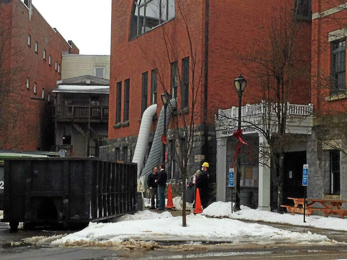 Crews work to clean-up water damage at New Hartford Town Hall, which will be closed the week of Jan. 6, 2014 while repairs are made.
