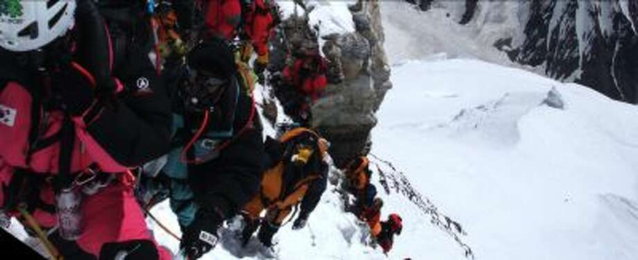 """The trek back down K2 is more dangerous than the ascent, a point made all too clear in """"The Summit,"""" a documentary about two days in 2008 when 11 climbers on the mountain died. (IFC Films.) Photo: THE WASHINGTON POST / THE WASHINGTON POST"""