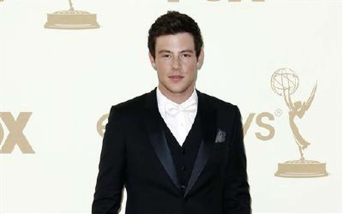 """Cory Monteith arrives at the 63rd Primetime Emmy Awards, in Los Angeles. """"Glee"""" launched its new season Thursday, Sept. 26, 2013, with the first episode of a two-part Beatles tribute. Lea Michele's character, Rachel, looks at a cell phone photo that includes a group shot with Monteith's character, Finn, in it. She sings the Beatles' """"Yesterday"""" in the scene. (AP Photo/Matt Sayles)"""