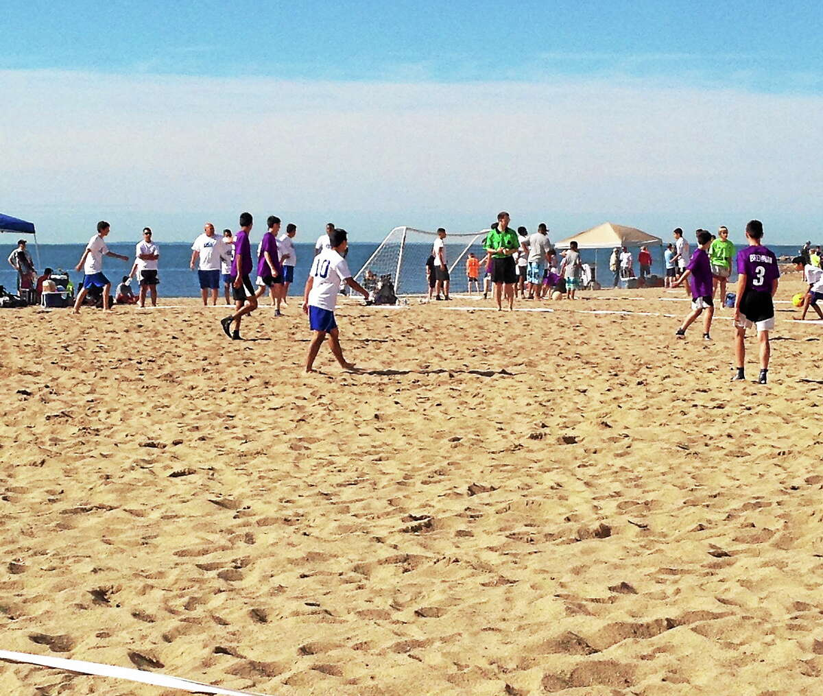 Youth soccer teams play at the 2014 Soccer Resort New England Beach Blitz on West Haven Beach. Teams play for 30 minutes on a 30-by-40 yard field.
