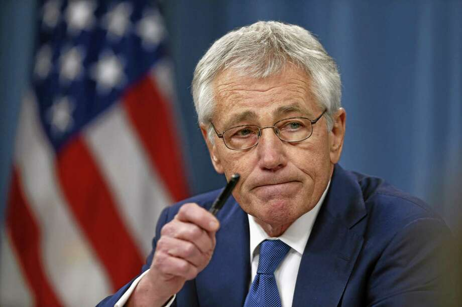 In this Dec. 19, 2013, photo, Defense Secretary Chuck Hagel takes questions as he briefs reporters at the Pentagon in Washington. Veterans groups are fighting part of the new budget deal signed into law Dec. 20 that curbs annual pension increases for military retirees under age 62. After a barrage of protests from the military community, lawmakers said they'll review the cut next year and possibly reverse it.(AP Photo/Charles Dharapak) Photo: AP / AP