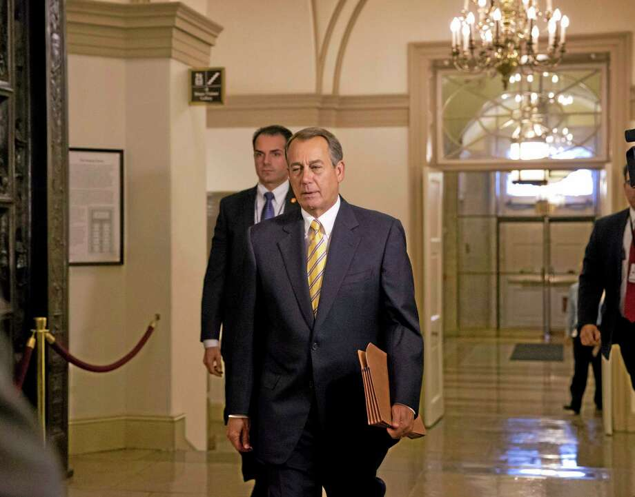 House Speaker John Boehner of Ohio arrives on Capitol Hill in Washington, Wednesday, Oct. 9, 2013. President Barack Obama is pressuring Boehner to hold votes to avoid a potentially catastrophic default and re-open the federal government, as a new poll indicated Republicans could pay a political price for Washington's fiscal paralysis.  (AP Photo/J. Scott Applewhite) Photo: AP / AP