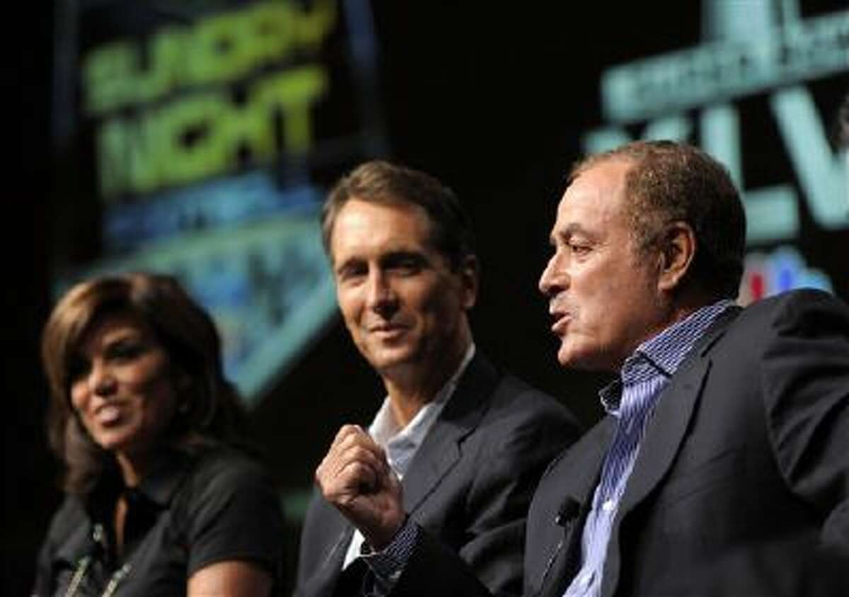 """Al Michaels, right, play-by-play commentator for """"Sunday Night Football,"""" takes part in a panel discussion on the show with game analyst Chris Collinsworth, center, and sideline reporter Michele Tafoya at the NBC Universal summer press tour, Monday, Aug. 1, 2011, in Beverly Hills, Calif."""