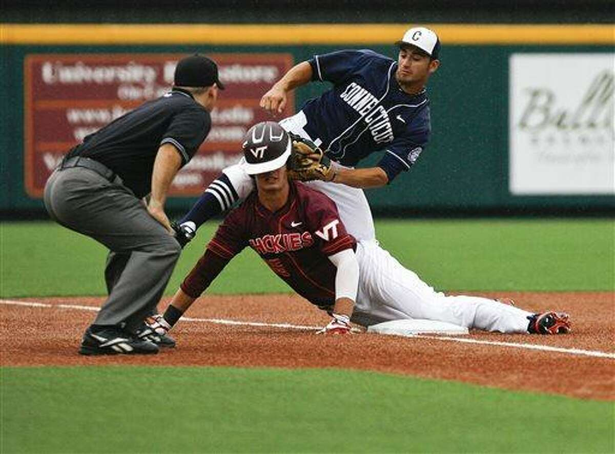 UConn's Vinny Siena, top, tags out Virginia Tech's Sean Kaselica, bottom, during the top of the fifth inning of an NCAA college baseball tournament regional game at English Field in Blacksburg, Va., Sunday, June 2, 2013. (AP Photo/Michael Shroyer)