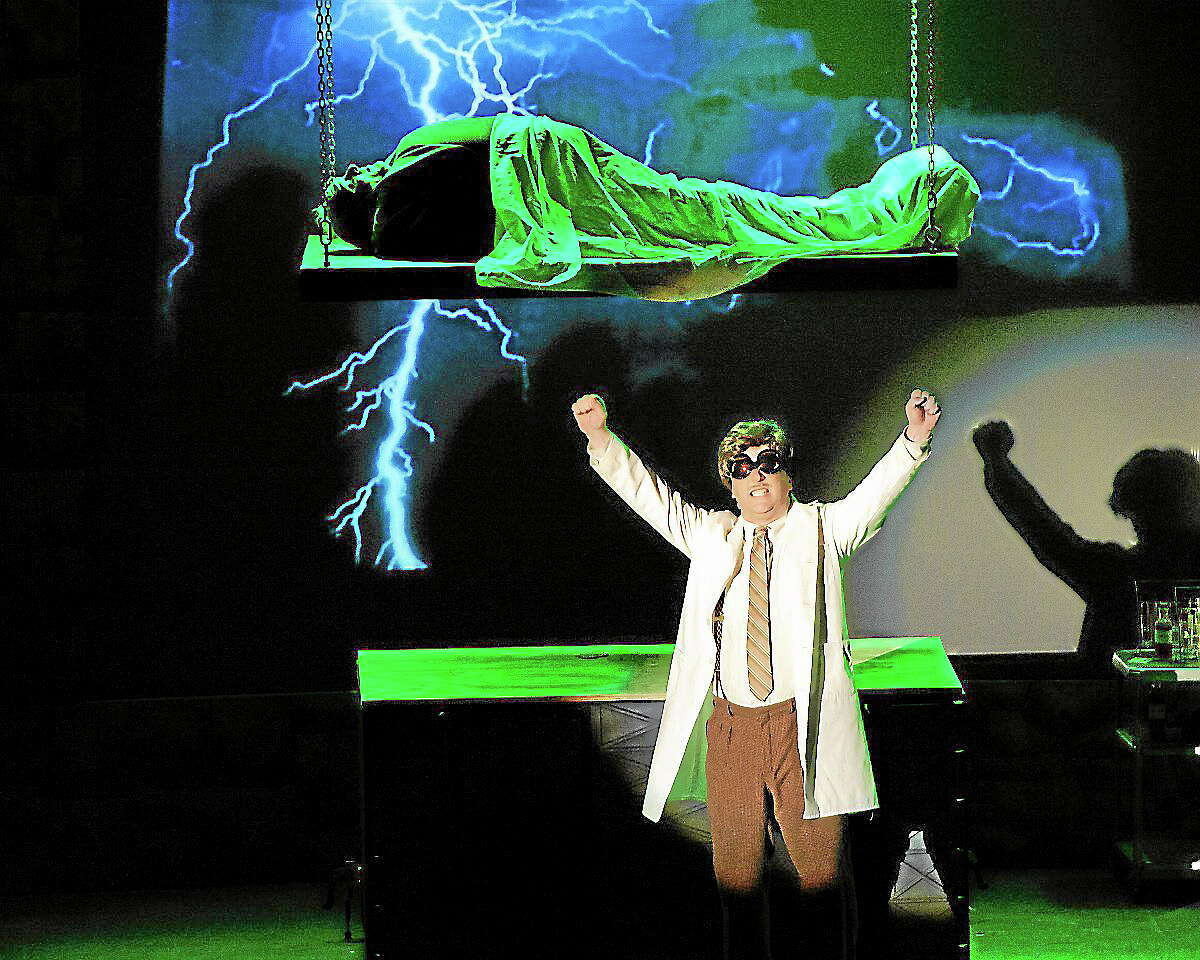 """Submitted photo - Landmark Community Theatre Chuck Stango as Dr. Frankenstein with John Mullens, above playing the monster, in the Landmark Theater Association's production of """"Young Frankenstein."""""""