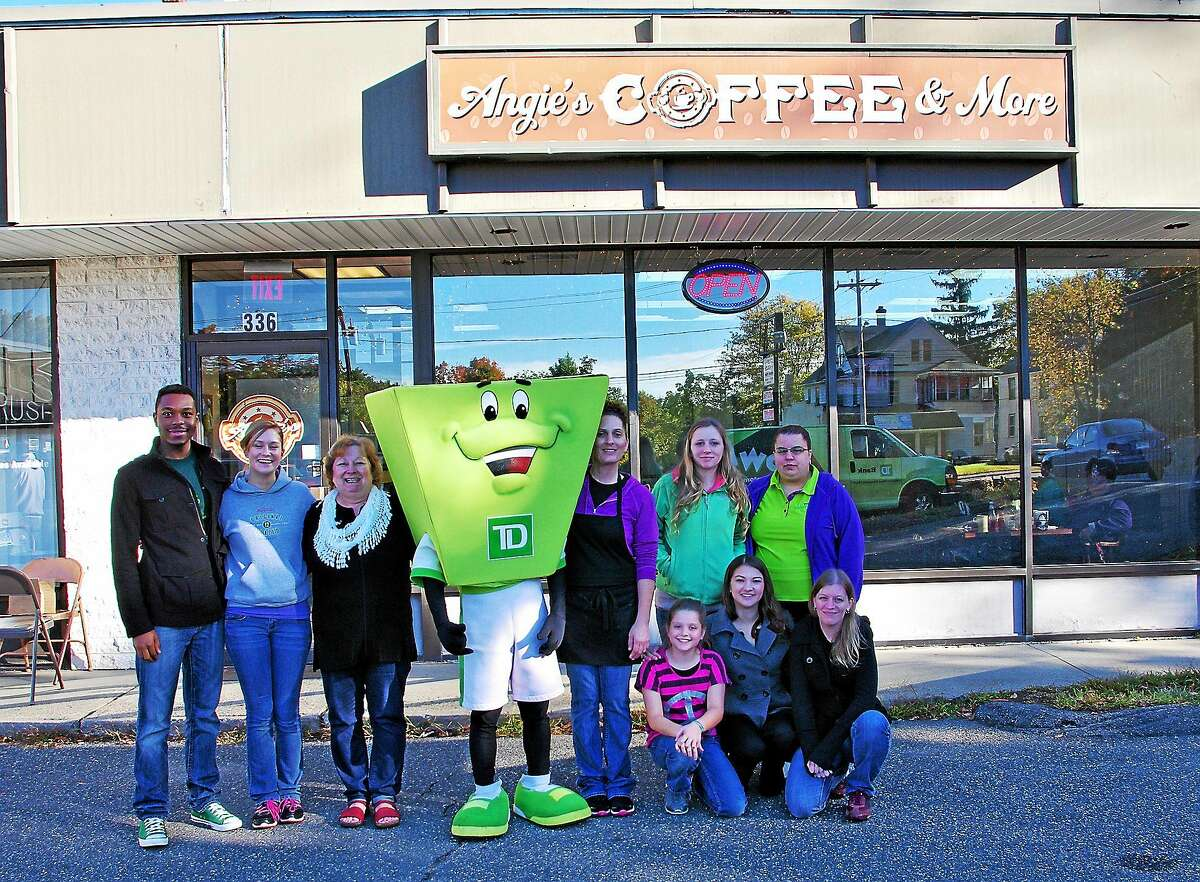 Employees of the Torrington TD Bank branch pose for a photo with Angela Lawlor Rimbach, owner of Angie's Coffee and More Sunday, and her staff Sunday. The bank covered the cost of meals served at the coffee shop between 8 and 10 a.m. as a way to thank their loyal business customers.