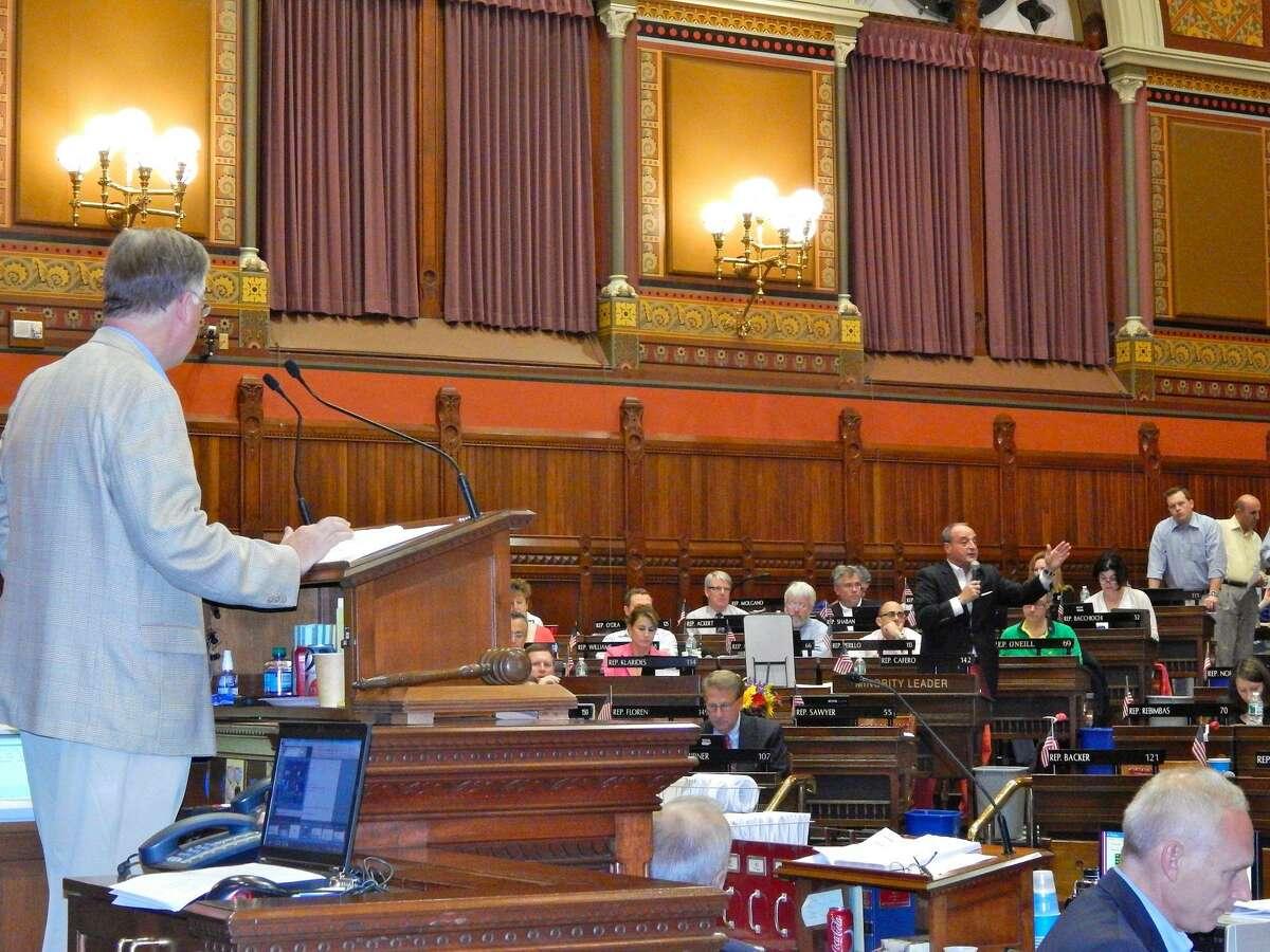 House Speaker J. Brendan Sharkey watches House Minority Leader Lawrence Cafero object to budget. CTMirror.org photo.