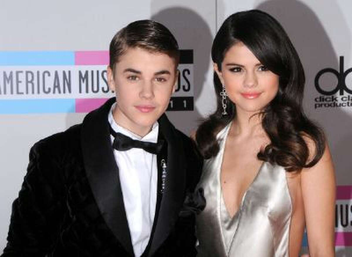 Singer Justin Bieber and singer/actress Selena Gomez arrive at the 2011 American Music Awards held at Nokia Theatre L.A. Live on November 20, 2011 in Los Angeles, California.