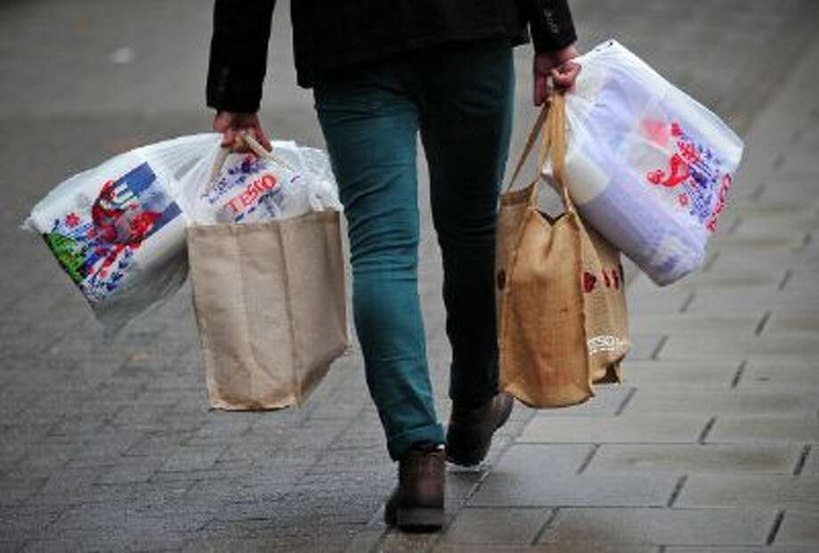 With more Brits shopping for groceries online and fewer on foot, grocers are adjusting their footprint to include more warehouse space. Photo: AFP/Getty Images / 2013 AFP