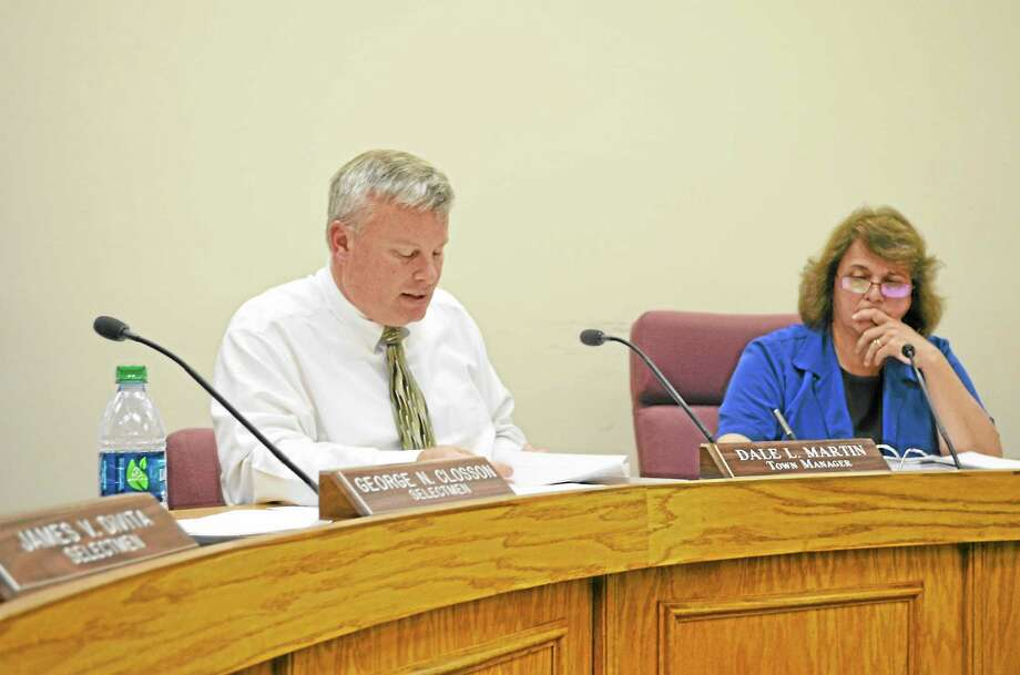 Town Manager Dale Martin, seated next to Mayor Maryann Welcome gives the selectmen their financial options during Monday's board of selectmen meeting. Photo: Journal Register Co.