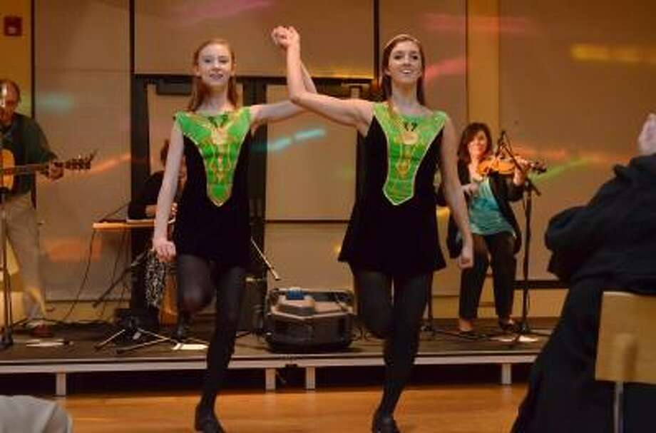 Irish Step Dancers from the Nationally Ranked Griffith Academy perfromed at the Litchfield Community Center's Irish Fest.   Kate Hartman/Register Citizen