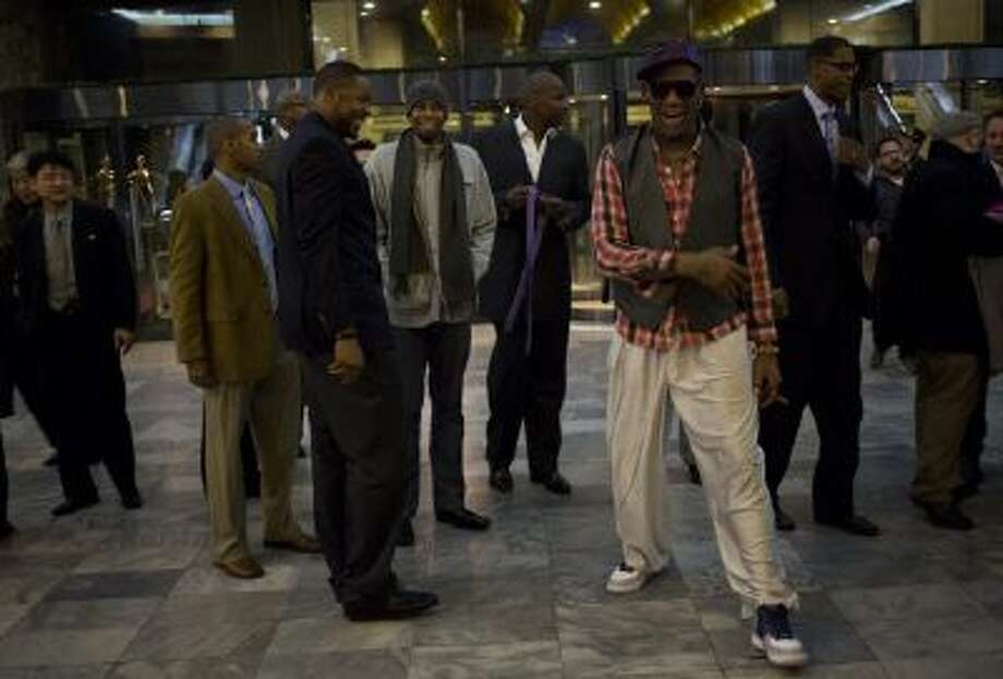 Former NBA basketball star Dennis Rodman, foreground right, and fellow U.S. basketball players arrive at a hotel in Pyongyang, North Korea.