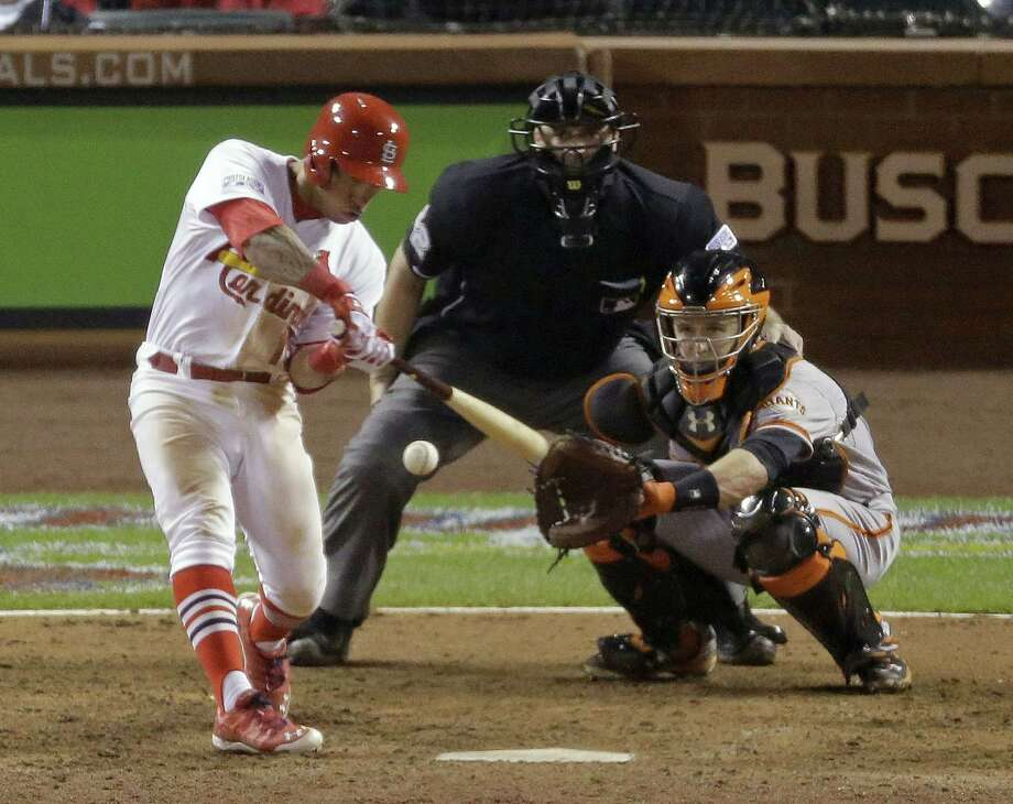 The Cardinals' Kolten Wong hits a walk off home run in Game 2 of the NLCS Sunday against the Giants. Photo: Eric Gay — The Associated Press  / AP