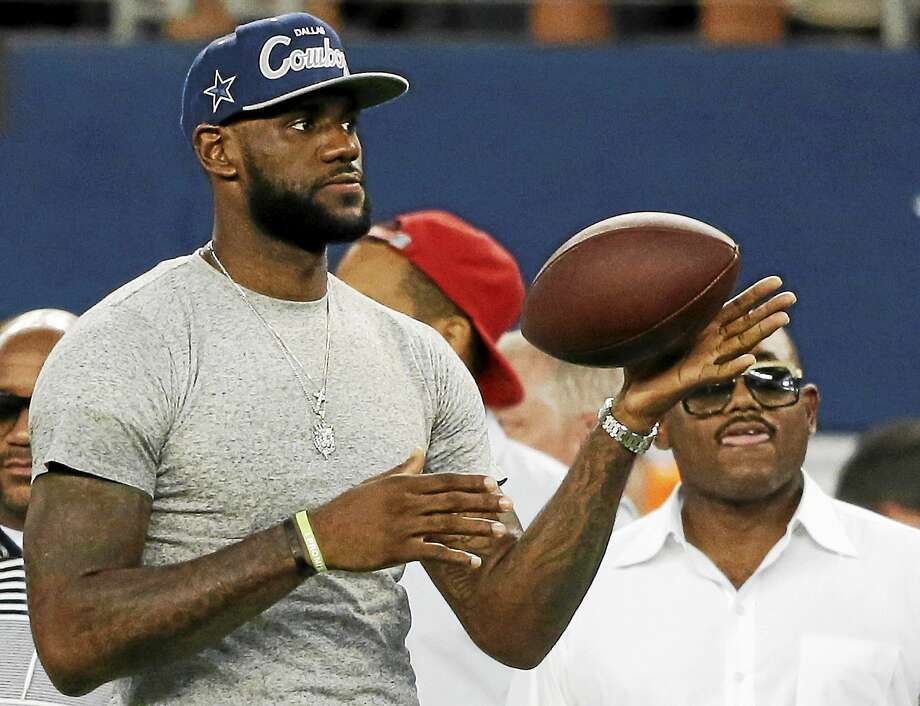 LeBron James is a lifelong Dallas Cowboys fan, but Browns QB Brian Hoyer is hoping to get the Cavaliers' superstar on the side of the Browns. Photo: The Associated Press File Photo  / AP2013
