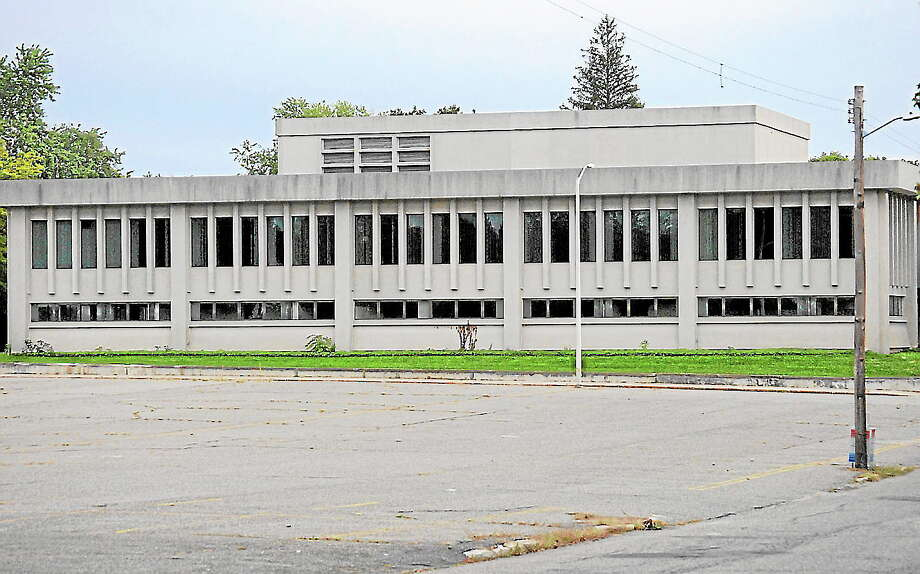Clark Street, between Clinton and Field streets, is set to become part of the state's courthouse complex. The decision on whether to discontinue the road, seen in this photo near the former Torrington Company building on Field Street, will be up to the city Planning and Zoning Commission and Town Council. Photo: File Photo — Register Citizen