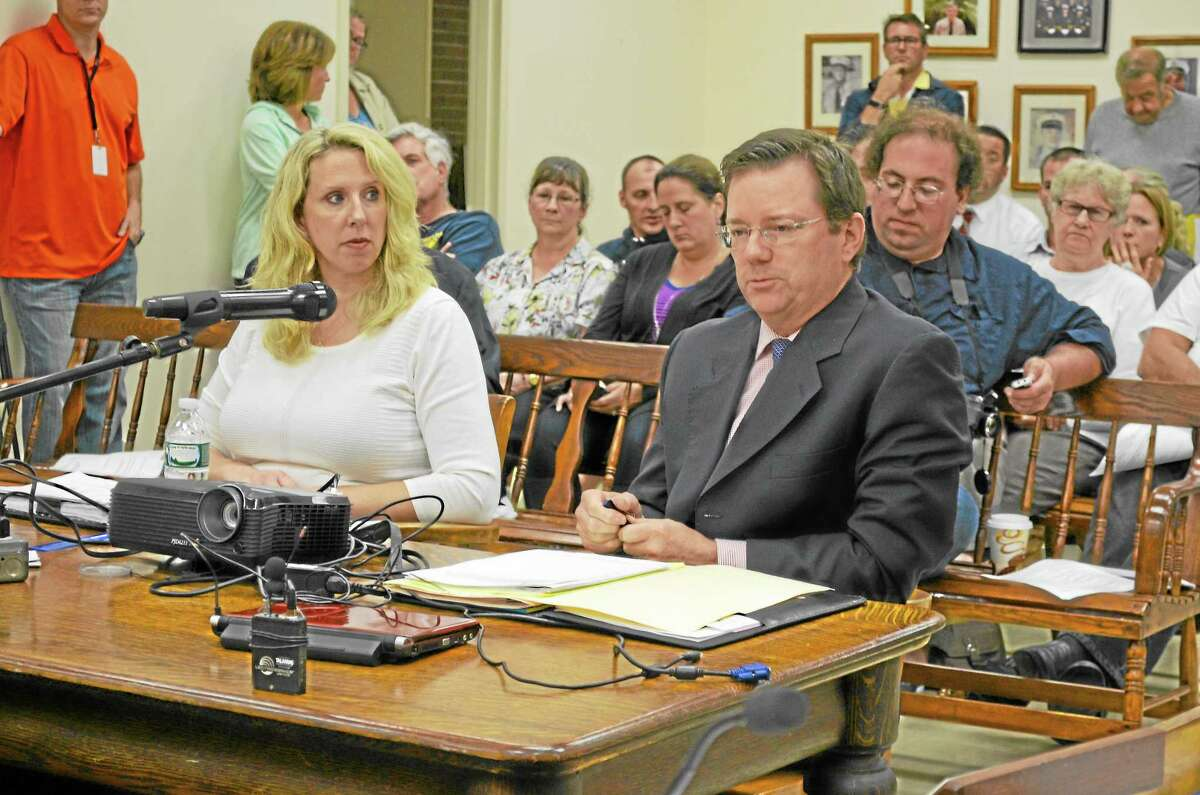 Finance Director Robin Manuele picture sitting with Town Attorney Kevin Nelligan during Monday's board of selectmen meeting