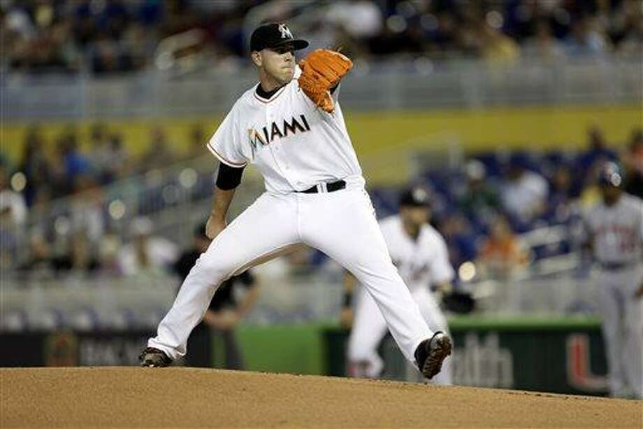 Miami Marlins starter Jose Fernandez throws to the New York Mets during the first inning of a baseball game in Miami, Saturday, June 1, 2013. (AP Photo/J Pat Carter) Photo: AP / AP