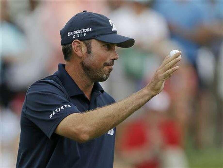 Matt Kuchar acknowledges the gallery after finishing his third round of the Memorial golf tournament Saturday, June 1, 2013, in Dublin, Ohio. (AP Photo/Darron Cummings) Photo: AP / AP