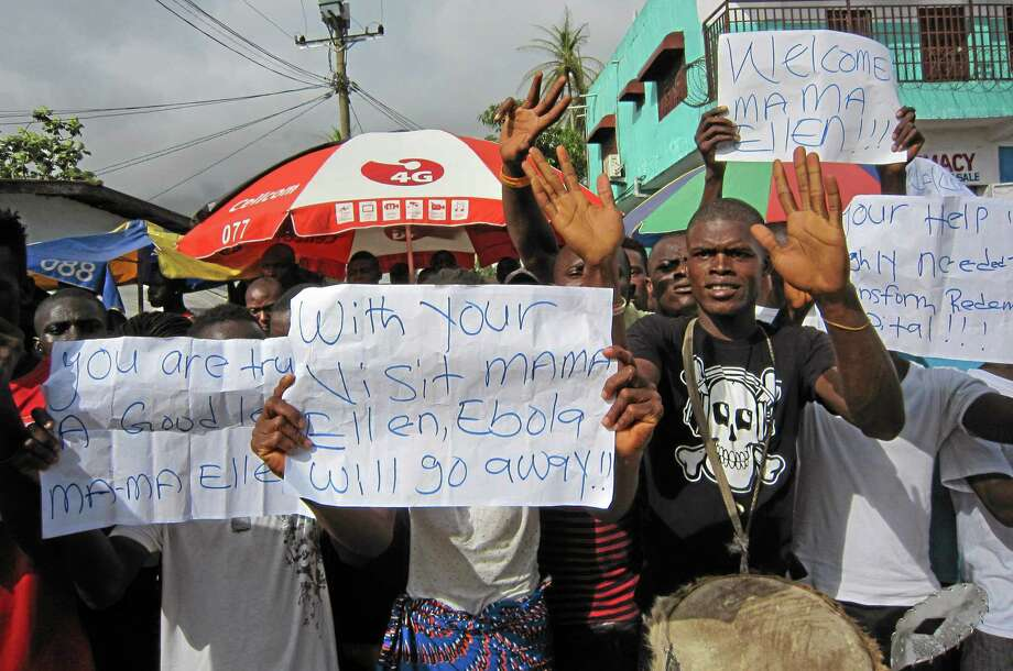 In this file photo taken on Tuesday, people protest outside a hospital as Liberia President Ellen Johnson Sirleaf visits the area after Ebola deaths in Monrovia, Liberia. A senior official for Doctors Without Borders says the Ebola outbreak ravaging West Africa is totally out of control and that the medical group is stretched to the limit in its capacity to respond. Photo: AP File Photo — Jonathan Paye-Layleh  / AP