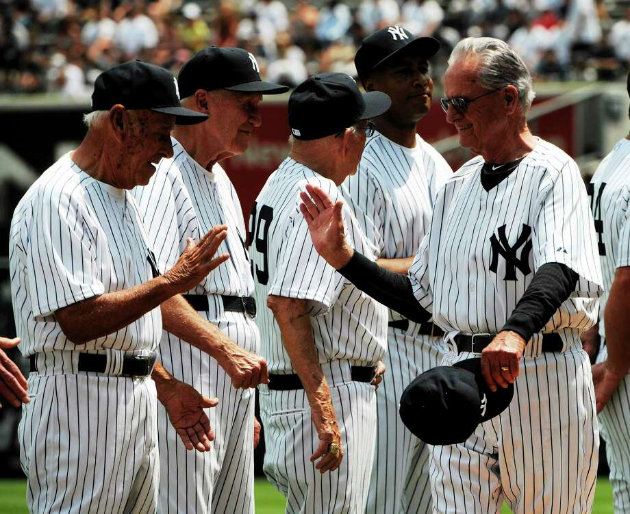 Former New York Yankees second baseman Jerry Coleman, right, reacts with other players during Old Timers' Day ceremonies Sunday, June 26, 2011 at Yankee Stadium in New York. (AP Photo/Bill Kostroun) Photo: AP / FR51951 AP