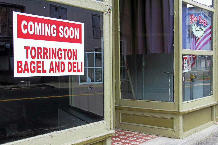 A sign outside the former site of a hot dog eatery on Water Street on Monday, Oct. 13, informs the public a deli and bagel shop is coming. The store owner is hoping the eatery will open early next month. Photo: Esteban L. Hernandez — The Register Citizen