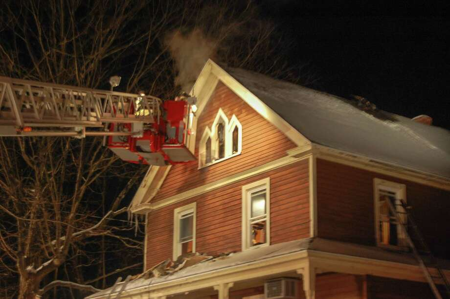 Firefighters battled a second-alarm fire at 144 Boyd St. in Winsted Saturday night. No injuries were reported at the scene. Photo: Isaac Avilucea—Register Citizen