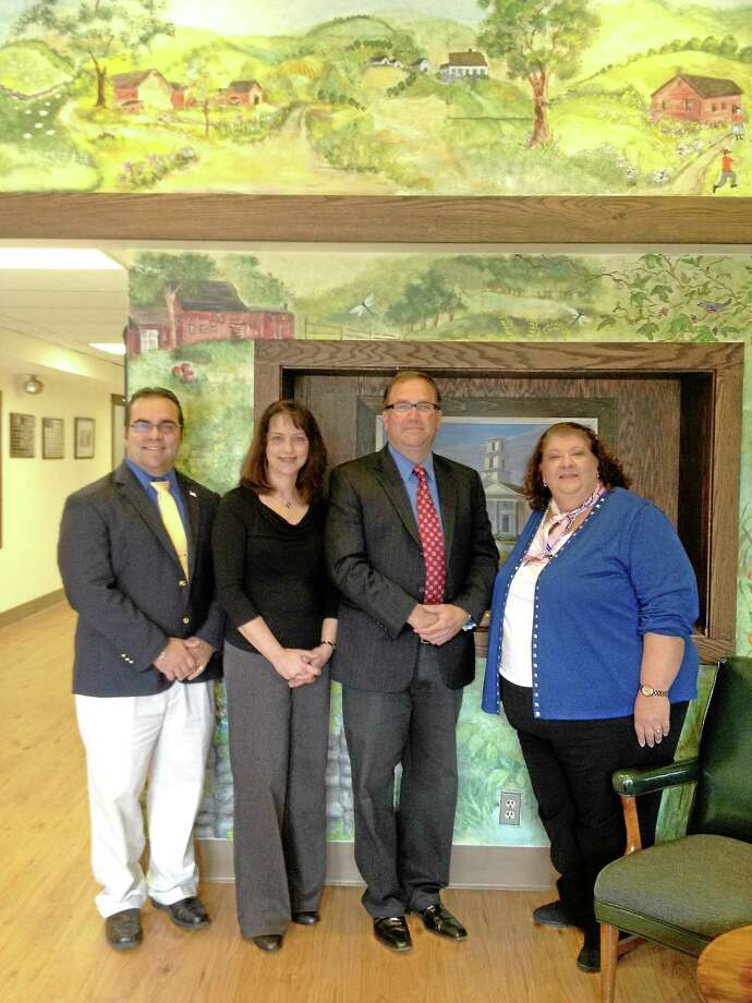 Harwinton First Selectman Mike Criss, Harwinton Social Services Director Melissa Santoro, Burlington First Selectman Ted Shafer and Burlington Social Services Director Eleanor Parente stand as a celebration for both town's receiving a $300,000 Small Cities Grant from the state in 2012 in order to rehabilitate homes in the area. Photo: Register Citizen File Photo
