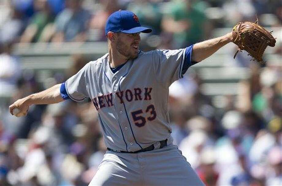 New York Mets pitcher Jeremy Hefner delivers a pitch during the first inning of an exhibition spring training baseball game against the Atlanta Braves on Friday, March 15, 2013, in Kissimmee, Fla.  (AP Photo/Evan Vucci) Photo: ASSOCIATED PRESS / AP2013