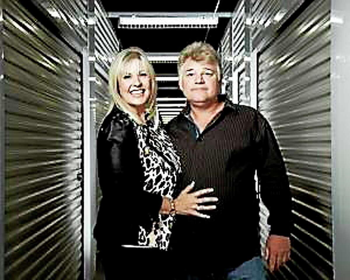 """Married auctioneer team Laura Dotson, left, and Dan Dotson are seen in a storage unit from their reality series, """"Storage Wars."""" Dan Dotson was in the hospital Friday recovering from surgery after suffering a double aneurysm, he wife said."""