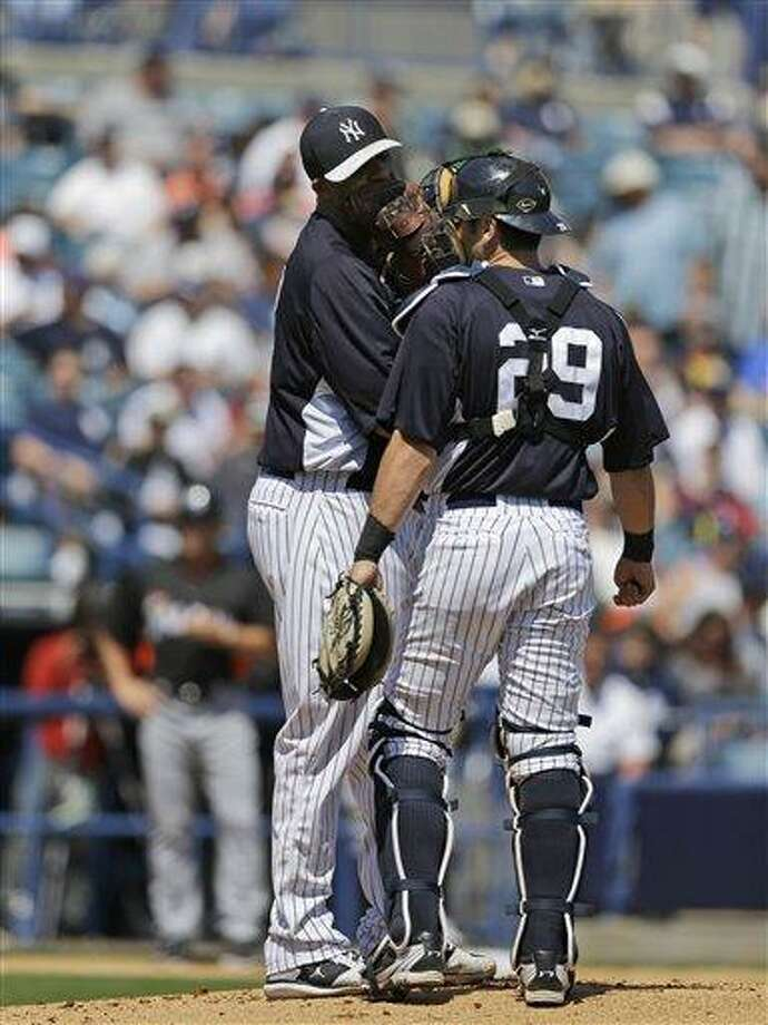 New York Yankees starting pitcher CC Sabathia, left, talks to New York Yankees catcher Francisco Cervelli (29) on the mound in a spring training baseball game against the Miami Marlins in Tampa, Fla., Friday, March 15, 2013.  (AP Photo/Kathy Willens) Photo: ASSOCIATED PRESS / AP2013