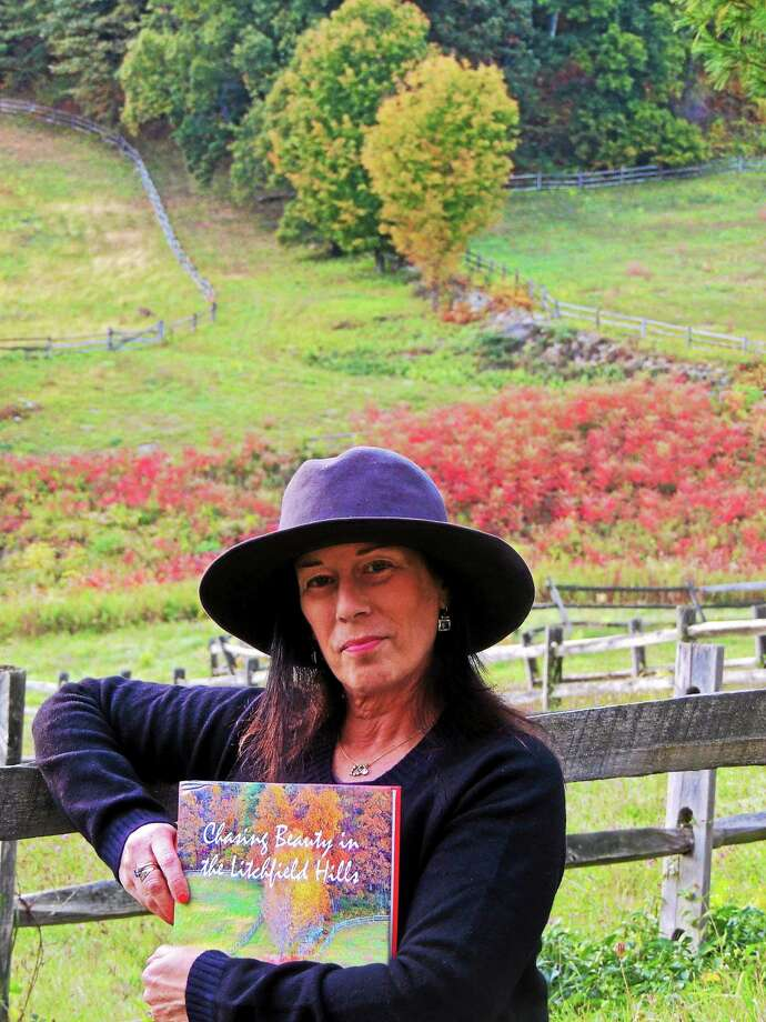 Lesley Meyer, of Kent, with her debut photography book that was released in October. Photo: Contributed Photo