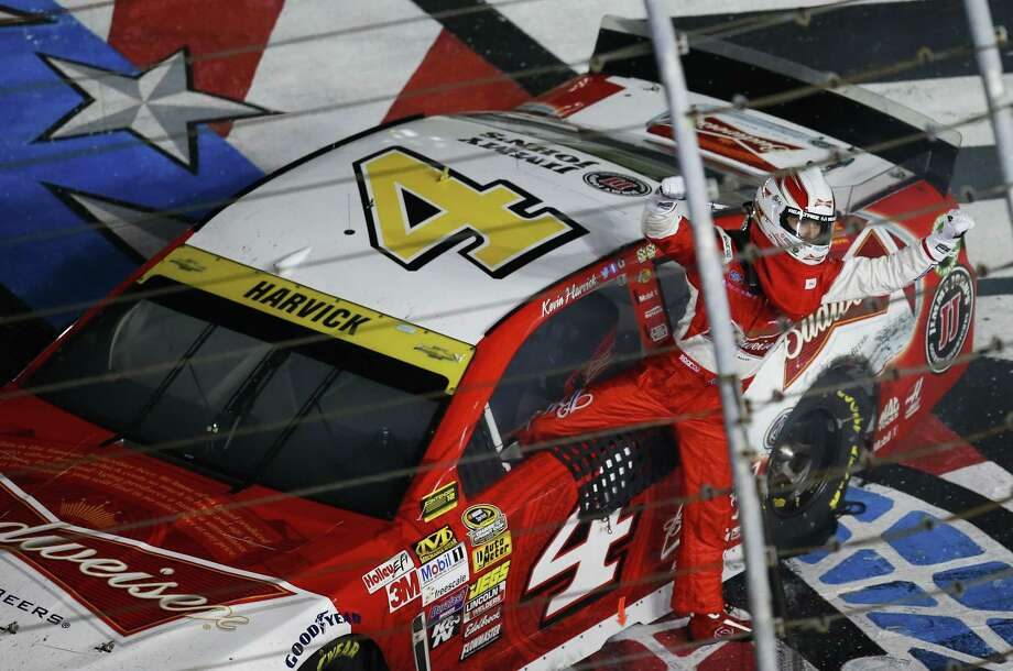 Kevin Harvick celebrates after winning the Bank of America 500 at Charlotte Motor Speedway on Saturday. Photo: Chris Keane — The Associated Press  / FR127116 AP