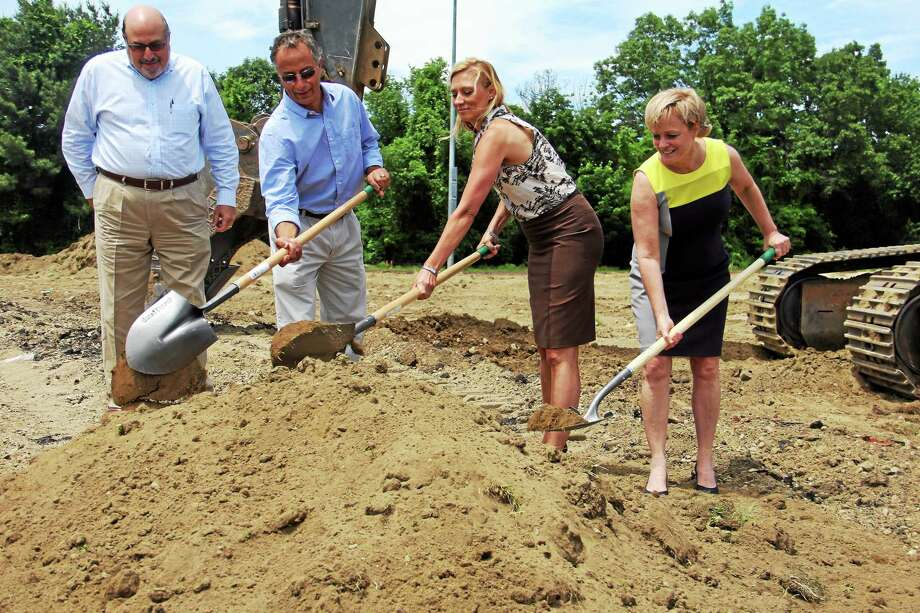 From left: Ed Arum, Mario Longobucco, State Rep. Michelle Cook, and Torrington Mayor Elinor Carbone participate in a groundbreaking ceremony for a new Torrington High School athletics complex Friday. Photo: Isaac Avilucea — The Register Citizen
