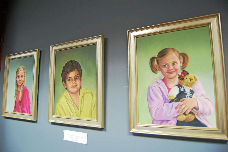 Paintings by Kathryn Boughton on display in the Register Citizen Newsroom Cafe. Photo: Tom Caprood—Register Citizen