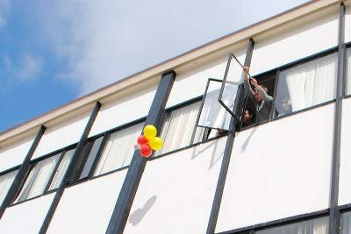Photos by Jessica Glenza/Register Citizen Jacob Delventhal drops his physics egg drop experiment from Torrington High Schoolís second story window.