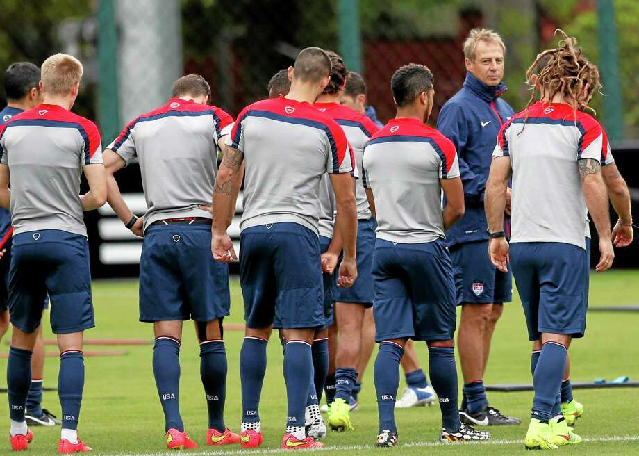 United States head coach Jurgen Klinsmann stands with his team during a training session Thursday in Sao Paulo, Brazil. Photo: Julio Cortez — The Associated Press  / AP