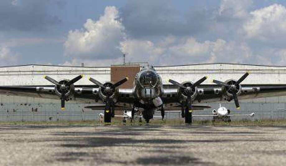 "The B-17G ""Yankee Lady"" is shown in front of the old Willow Run Bomber Plant at Willow Run Airport in Ypsilanti Township, Mich., The bomber plant west of Detroit was where, at President Franklin Roosevelt's urging, Ford Motor Co. switched from making cars to planes and produced one an hour - nearly 9,000 B-24 Liberator bombers in all - to help win the war in Europe. At the time of its 1940s construction, the plant was the largest factory in the world, employing 40,000 men and women, including Rose Will Monroe, who was believed to have been the inspiration for the famed Rosie the Riveter character. (Associated Press/Paul Sancya) Photo: AP / AP"