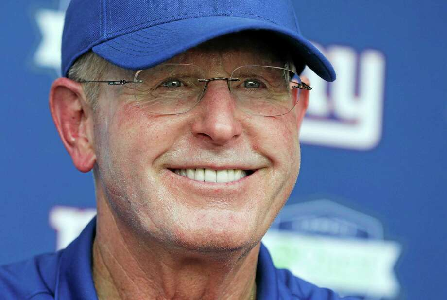 New York Giants head coach Tom Coughlin talks with the media after workouts at their minicamp on Tuesday in East Rutherford, N.J. Photo: Julie Jacobson — The Associated Press  / AP