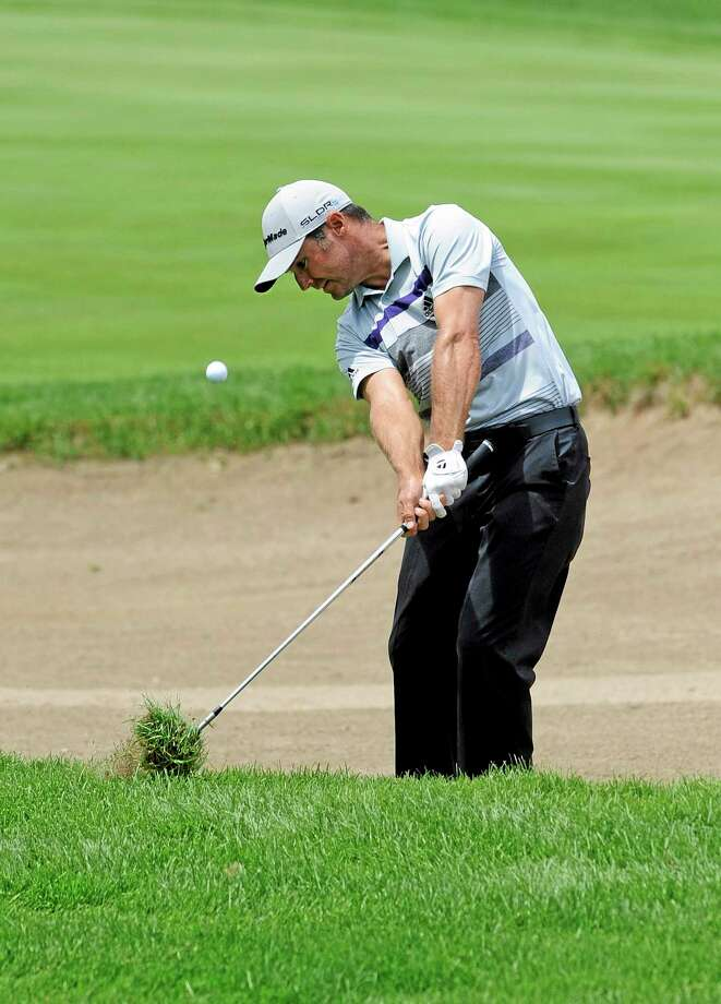Trevor Immelman, here hitting out of the rough on the 9th hole, made double-eagle on the par-5 13th hole during the first round of the Travelers Championship Thursday in Cromwell. Photo: Fred Beckham — The Associated Press  / FR153656 AP