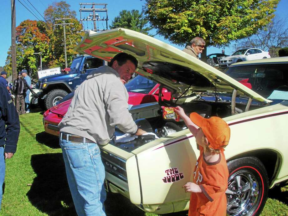 Photos by Stephen Underwood Car enthusiasts of all ages attended the Connecticut Junior Republic's Cars for Kids show in Litchfield on Sunday, Oct. 12. Above, a father and son admire a Dodge GTO. Photo: Journal Register Co.