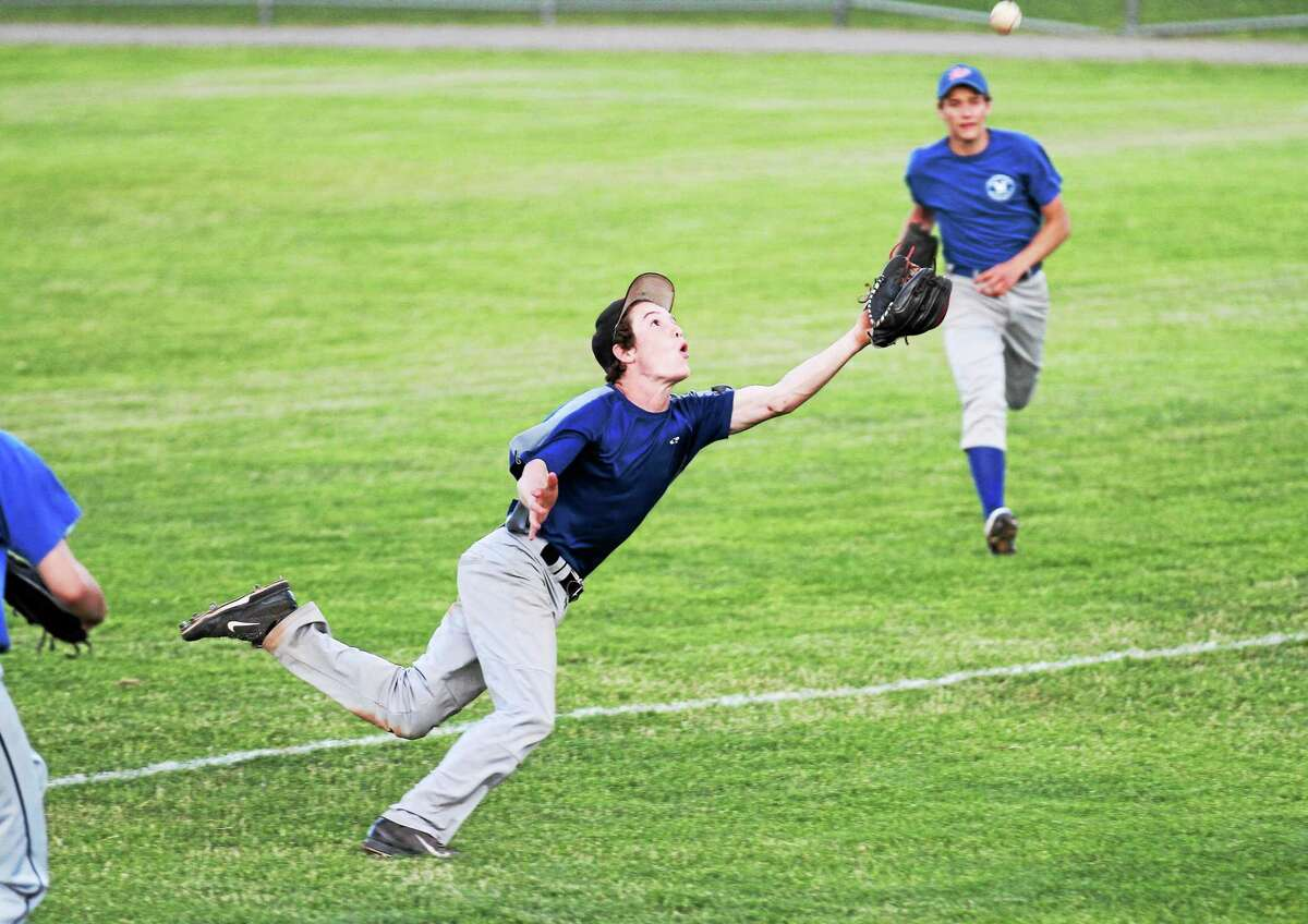 Winsted's Garrett Healy lays up to make a diving catch in the its 6-5 win over the Torrington P38s.