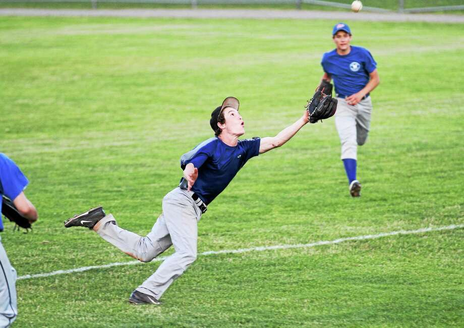 Winsted's Garrett Healy lays up to make a diving catch in the its 6-5 win over the Torrington P38s. Photo: Marianne Killackey — Special To The Register Citizen  / 2013