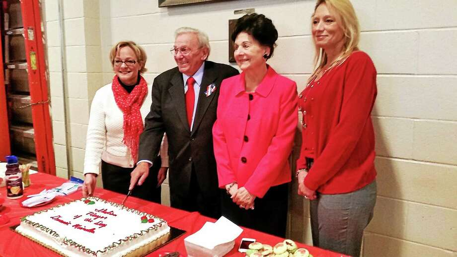 Photos by N.F. Ambery From left, Torrington Mayor Eleanor Carbone, Italian Mayor for the Day Domenic Mainella, his wife Marie and state Rep. Michelle Cook gather with guests, friends and family for Torrington's annual Columbus Day celebration and honoring of Mainella, Oct. 12. Photo: Journal Register Co.