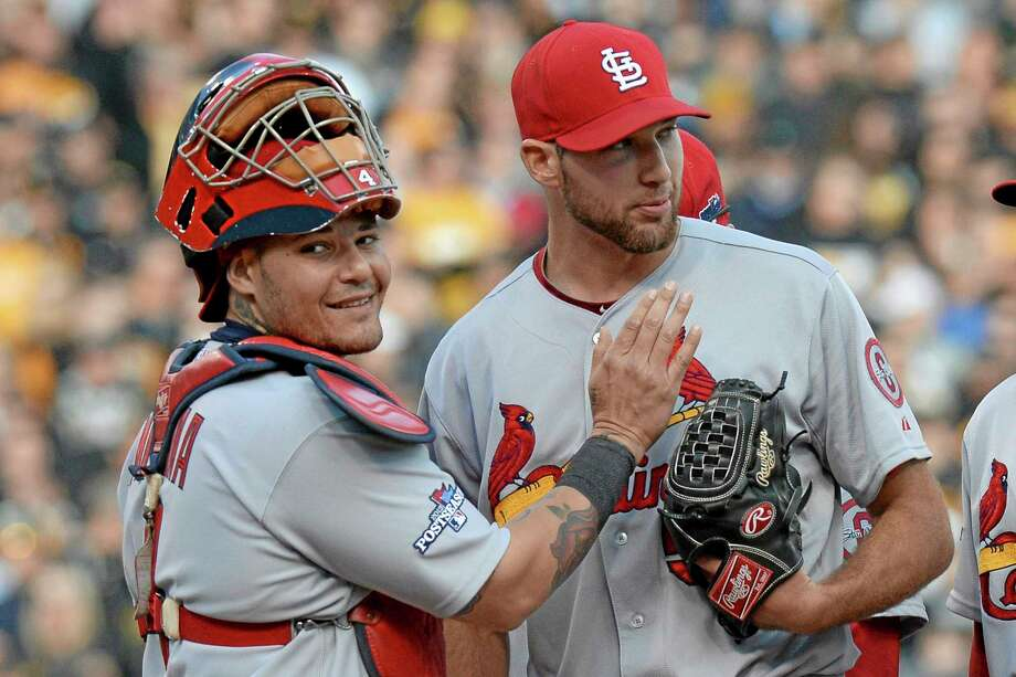 Cardinals catcher Yadier Molina, left, pats starting pitcher Michael Wacha right before he was lifted from the game in the eighth inning Monday. Photo: Don Wright — The Associated Press  / FR87040 AP